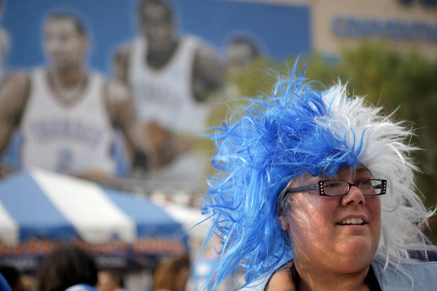 Mitzi Carter of Oklahoma City waits to get her face painted before game 4 of the Western Conference Finals in the NBA basketball playoffs between the Dallas Mavericks and the Oklahoma City Thunder at the Oklahoma City Arena in downtown Oklahoma City, Monday, May 23, 2011. Photo by Bryan Terry, The Oklahoman