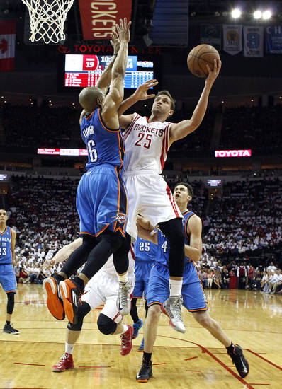 Houston's Chandler Parsons (25) shoots a lay up as Oklahoma City's Derek Fisher (6) defends during Game 3 in the first round of the NBA playoffs between the Oklahoma City Thunder and the Houston Rockets at the Toyota Center in Houston, Texas, Sat., April 27, 2013. Photo by Bryan Terry, The Oklahoman