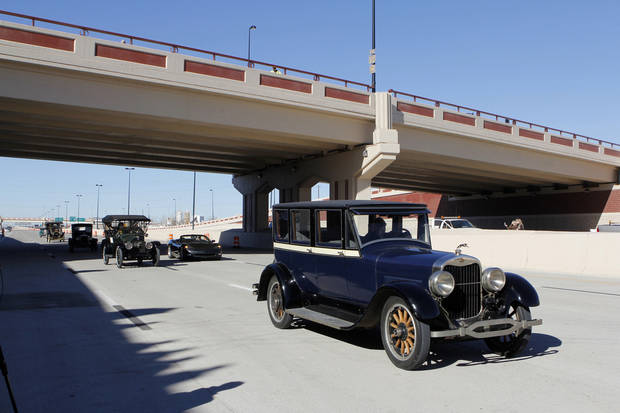 Antique cars cross under the Western Ave. bridge on Thursday during grand opening ceremonies for the eastbound lanes of the Interstate 40 Crosstown in Oklahoma City. Photo by Paul B. Southerland, The Oklahoman