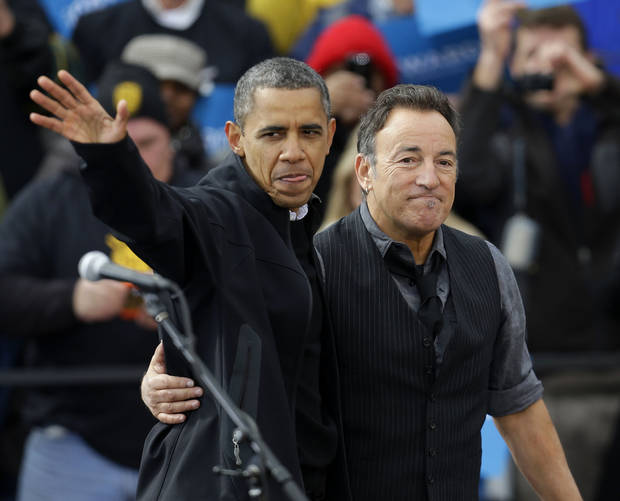 President Barack Obama, accompanied by singer Bruce Springsteen, waves as he arrive at a campaign event near the State Capitol Building in Madison, Wis., Monday, Nov. 5, 2012. (AP Photo/Pablo Martinez Monsivais)