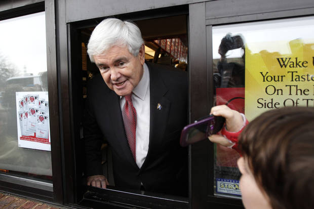 Republican presidential candidate, former House Speaker Newt Gingrich, campaigns at a Chick-Fil-A in Anderson, S.C., Saturday, Jan. 21, 2012, on South Carolina's Republican primary election day.  (AP Photo/Matt Rourke) ORG XMIT: SCMR121