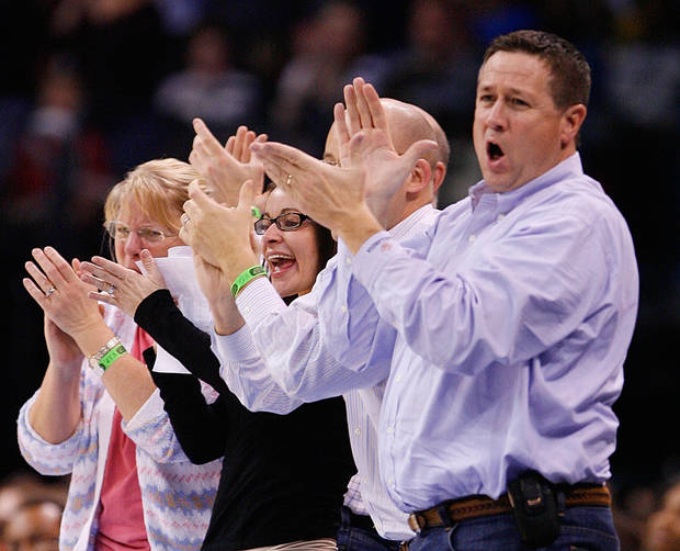 Fans react to a tie score late in the second half as the Oklahoma City Thunder plays the Houston Rockets at the Ford Center in Oklahoma City, Okla. on Friday, January 9, 2009. 