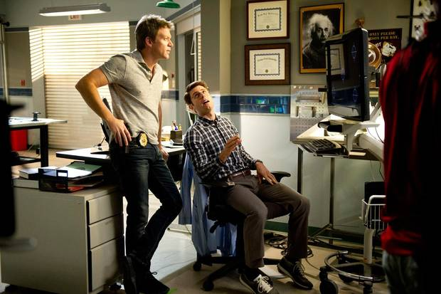 "From left, Matt Passmore and Jordan Wall are shown in a scene from ""The Glades."" - Photo credit: ©2013 A+E Networks / Photo credit: Jeff Daley"