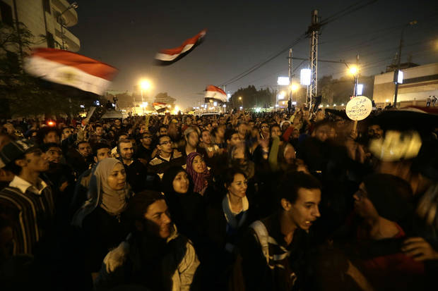 Egyptian protesters chant anti Muslim Brotherhood and Egyptian President Mosri slogans outside the presidential palace in Cairo, Egypt, Thursday, Dec. 6, 2012. The Egyptian army has deployed tanks outside the presidential palace in Cairo following clashes between supporters and opponents of Mohammed Morsi that left several people dead and hundreds wounded. (AP Photo/Hassan Ammar)