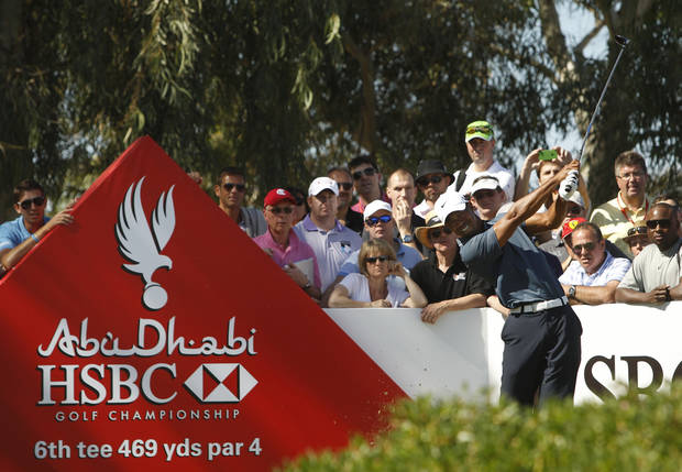 Tiger Woods from  the U.S. tees off on the 6th hole during the second round of Abu Dhabi Golf Championship in Abu Dhabi, United Arab Emirates, Friday, Jan. 18, 2013. (AP Photo/Kamran Jebreili)