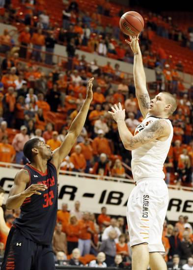Oklahoma State's Philip Jurick (44) shoots over Texas Tech's Jordan Tolbert (32) during a men's college basketball game between Oklahoma State University (OSU) and Texas Tech at Gallagher-Iba Arena in Stillwater, Okla., Saturday, Jan. 19, 2013.  Photo by Nate Billings, The Oklahoman