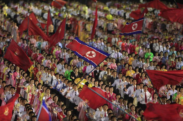 In this Monday, April 16, 2012 photo, students wave the national flags at an evening dancing party and performance at Kim Il Sung Square to commemorate late President Kim Il Sung's 100th birthday in Pyongyang, North Korea. AP photo <strong>Ng Han Guan</strong>