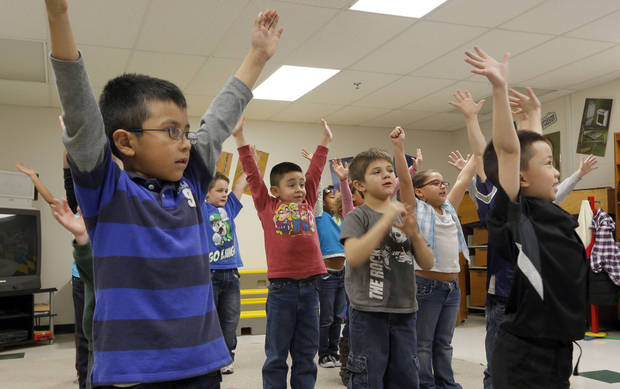 Above: First-grade students put motion to music in Christy Gosset�s music class.