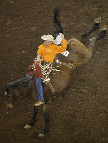 Clovis Crane of Lebanon, Pa., competes in bareback riding during the PRCA National Circuit Finals Rodeo at the State Fair Arena on Friday, March 30, 2012. Photo by Bryan Terry, The Oklahoman