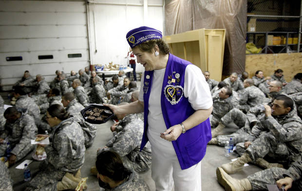 Margaret Schipper hands out brownies to soldiers from Ft. Sill traveling home for the holidays at the YMCA Military Welcome Center at Will Rogers World Airport, Saturday, Dec. 18, 2010, in Oklahoma City. Photo by Sarah Phipps, The Oklahoman