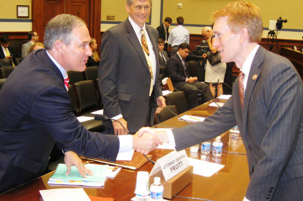 Oklahoma Attorney General Scott Pruitt, left, greets Rep. James Lankford, R-Oklahoma City, on Wednesday in Washington. The attorney general testified before a U.S. House hearing about Pruitt's lawsuit against the health care law.  PHOTO BY CHRIS CASTEEL, THE OKLAHOMAN  <strong>Chris Casteel - The Oklahoman</strong>