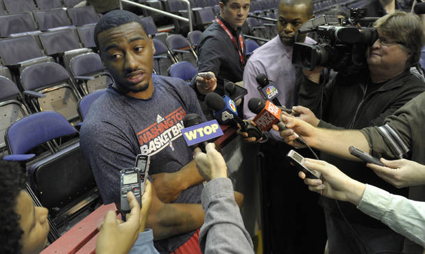 Washington Wizards point guard John Wall talks with the news media following a team practice at the Verizon Center in Washington, Monday, Dec. 17, 2012. Wall, the No. 1 overall pick in the 2010 draft, has been recovering from a stress injury to his left knee cap. AP Photo/Susan Walsh)