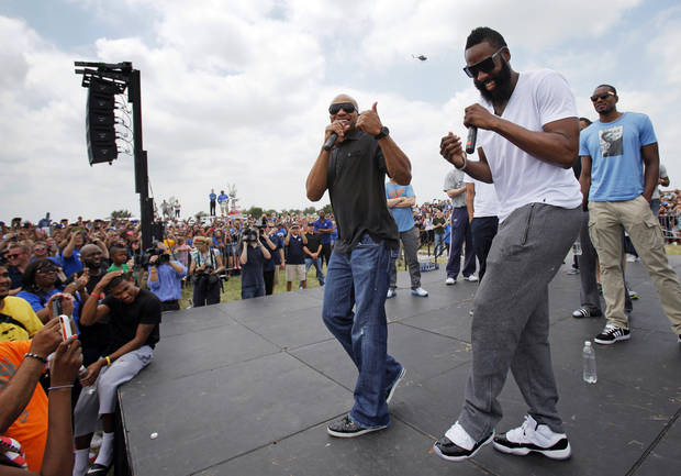 FANS / NBA BASKETBALL: James Harden, front right, laughs as Derek Fisher, left, speaks during a welcome home rally for the Oklahoma City Thunder in a field at Will Rogers World Airport after the team's loss to the Miami Heat in the NBA Finals, Friday, June 22, 2012. At right in the background is Serge Ibaka. Photo by Nate Billings, The Oklahoman