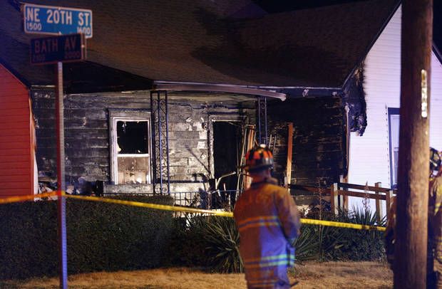 Firefighters work on a fatal house fire near NE 20 and Bath Avenue on Tuesday night. Photo by Sarah Phipps, The Oklahoman <strong>SARAH PHIPPS</strong>