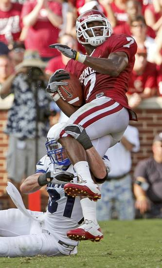 OU's DeMarco Murray is brought down by Brian Lindsay of Air Force during the second half of the college football game between the University of Oklahoma Sooners (OU) and Air Force (AF) at the Gaylord Family-Oklahoma Memorial Stadium on Saturday, Sept. 18, 2010, in Norman, Okla.   Photo by Bryan Terry, The Oklahoman