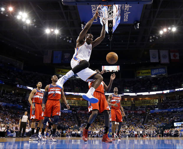 Oklahoma City's Kendrick Perkins (5) dunks the ball during an NBA basketball game between the Oklahoma City Thunder and the Washington Wizards at Chesapeake Energy Arena in Oklahoma City, Wednesday, March 19, 2013. Photo by Bryan Terry, The Oklahoman