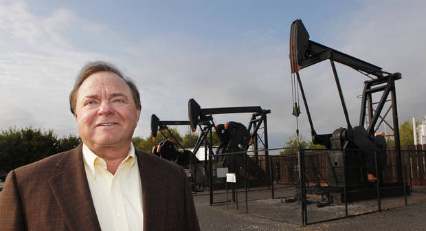Harold Hamm, CEO of Continental Resources, stands near some of the company's pump jacks. Photo by David McDaniel, The Oklahoman