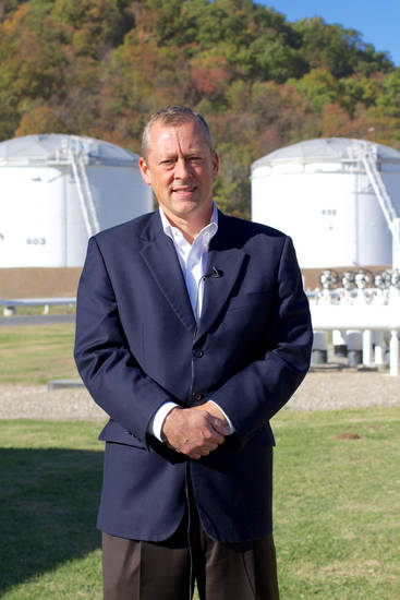 Magellan Midstream Partners CEO Mike Mears stands in front of gasoline and diesel storage tanks at the company's Tulsa terminal. <strong>Adam Wilmoth - photo by</strong>