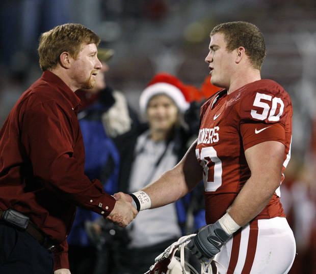 OU&#039;s Jon Cooper shakes hands with Don Key after receiving the Don Key Award before the college football game between the University of Oklahoma Sooners and Texas Tech University at the Gaylord Family -- Oklahoma Memorial Stadium on Saturday, Nov. 22, 2008, in Norman, Okla.   BY STEVE SISNEY, THE OKLAHOMAN  