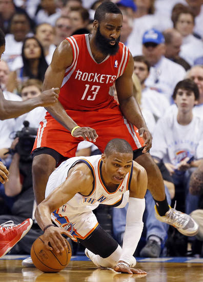 Oklahoma City's Russell Westbrook (0) tries to keep control of the ball in front of Houston's James Harden (13) during Game 2 in the first round of the NBA playoffs between the Oklahoma City Thunder and the Houston Rockets at Chesapeake Energy Arena in Oklahoma City, Wednesday, April 24, 2013. Photo by Nate Billings, The Oklahoman