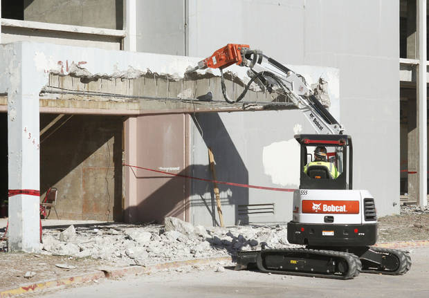 Demolition was under way Friday in preparation for renovation of the former Lincoln Plaza Hotel, 4345 N Lincoln Blvd., for use by Oklahoma Health Care Authority. Photos by PAUL HELLSTERN, The Oklahoman
