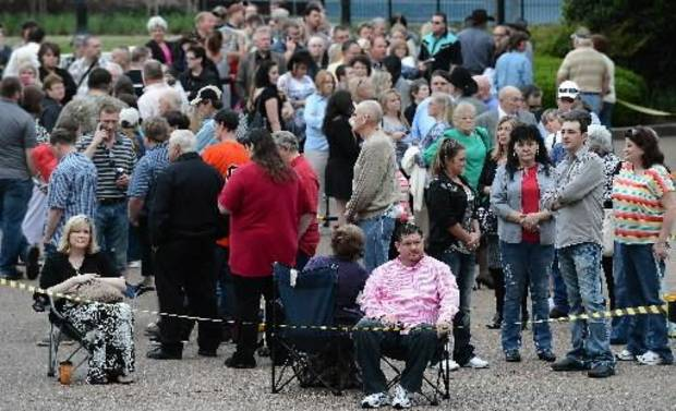 Jeff Long, of Carton Ga., pink shirt, waits with the crowd to enter the Grand Ole Opry House for the funeral of country music star George Jones on Thursday, May 2, 2013, in Nashville, Tenn. Jones, a country music legend who had No. 1 hits in four separate decades, died April 26. (AP)