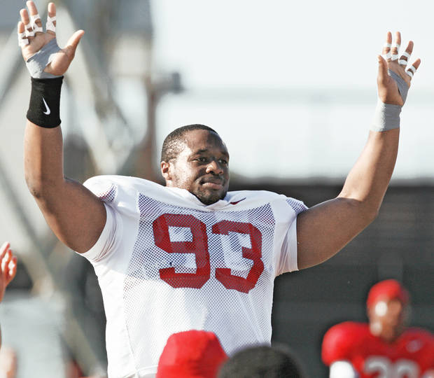 Gerald McCoy waves to the fans watching a practice earlier this season. McCoy is having the time of his life. Photo by Chris Landsberger, The Oklahoman