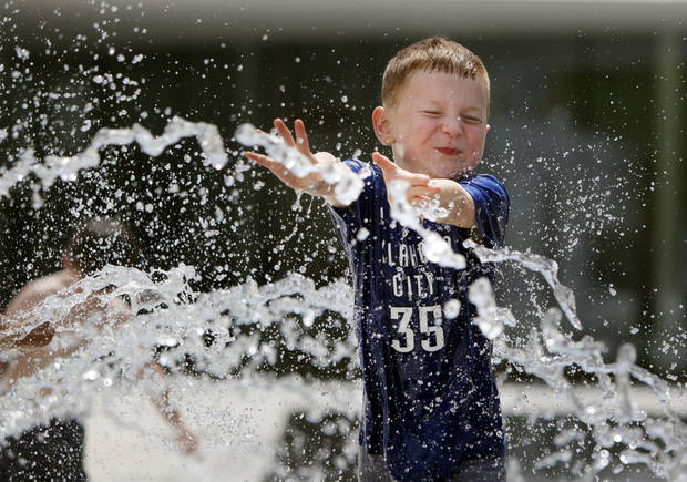 Joseph Dover, 4, runs through a fountain in the Myriad Gardens during the Festival of the Arts in downtown Oklahoma City, Wednesday, April 25, 2012. Photo by Nate Billings, The Oklahoman