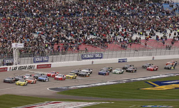 Drivers cross the start line at the beginning of the NASCAR Nationwide Series auto race, Saturday, March 9, 2013, in Las Vegas. (AP Photo/Julie Jacobson)