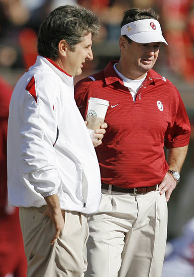Texas Tech head coach Mike Leach, left, and Oklahoma head coach Bob Stoops talk before the college football game between the University of Oklahoma Sooners (OU) and the Texas Tech University Red Raiders (TTU) at Jones AT&T Stadium in Lubbock, Texas, Saturday, Nov. 21, 2009. Photo by Nate Billings, The Oklahoman