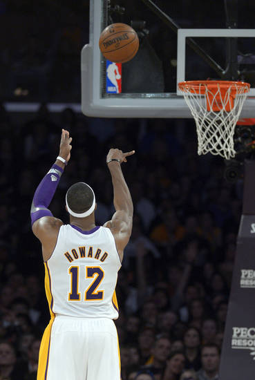 Los Angeles Lakers center Dwight Howard shoots a free throw during the second half of their NBA basketball game against the Orlando Magic, Sunday, Dec. 2, 2012, in Los Angeles. The Magic won 113-103. (AP Photo/Mark J. Terrill)