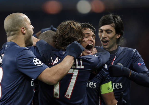 Paris Saint-Germain's players, including Thiago Silva, second right, celebrate his goal against FC Porto during their Champions League soccer match at the Parc des Princes stadium, in Paris, Tuesday, Dec. 4, 2012. (AP Photo/Christophe Ena)
