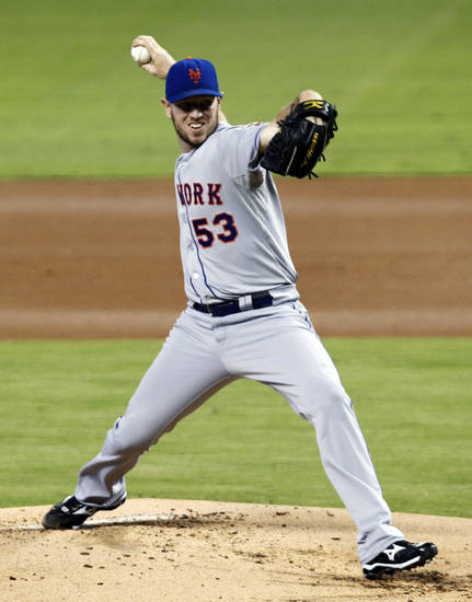 New York Mets' Jeremy Hefner pitches to the Miami Marlins in the first inning of a baseball game in Miami, Wednesday, Oct. 3, 2012. (AP Photo/Alan Diaz)