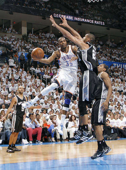 Oklahoma City's Kevin Durant (35) drives past San Antonio's Tim Duncan (21) during Game 6 of the Western Conference Finals between the Oklahoma City Thunder and the San Antonio Spurs in the NBA playoffs at the Chesapeake Energy Arena in Oklahoma City, Wednesday, June 6, 2012. Photo by Chris Landsberger, The Oklahoman