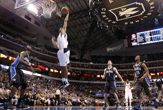 Dallas Mavericks' Brandan Wright (34) goes up for a dunk as Orlando Magic's Andrew Nicholson, J.J. Redick (7) and Ish Smith (10) watch during the second half of an NBA basketball game Wednesday, Feb. 20, 2013, in Dallas. The Mavericks won 111-96. (AP Photo/Tony Gutierrez)
