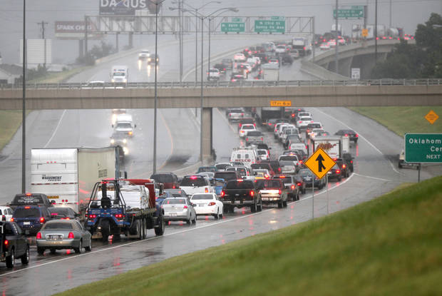 Cars are at a standstill on northbound Broadway Extension in Oklahoma City, OK, after heavy rains caused widespread flooding in the metro, Monday, June 14, 2010. By Paul Hellstern, The Oklahoman