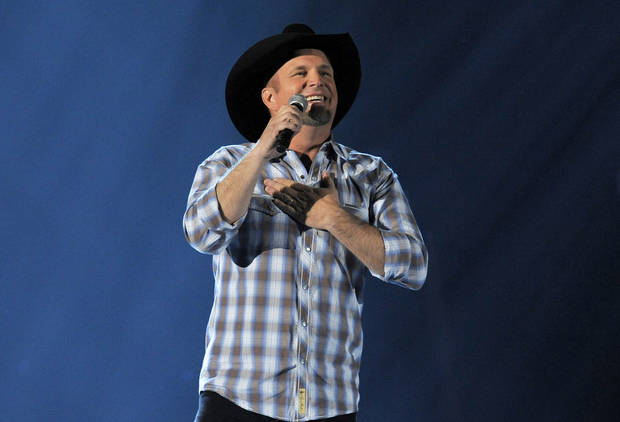 Garth Brooks performs at the 48th Annual Academy of Country Music Awards at the MGM Grand Garden Arena in Las Vegas on Sunday, April 7, 2013. (Photo by Chris Pizzello/Invision/AP) ORG XMIT: NVPM313 <strong>Chris Pizzello - Chris Pizzello/Invision/AP</strong>
