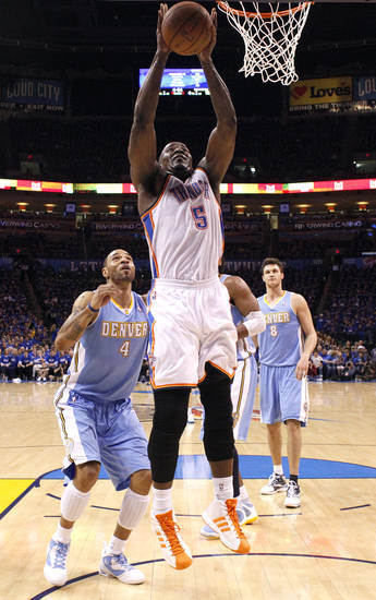Oklahoma City's Kendrick Perkins (5) shoots in front of Denver's Kenyon Martin (4) during the first round NBA basketball playoff game between the Oklahoma City Thunder and the Denver Nuggets on Wednesday, April 20, 2011, at the Oklahoma City Arena. Photo by Sarah Phipps, The Oklahoman