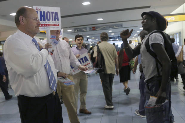 Republican mayoral candidate Joe Lhota, left, gets a thumbs up from a commuter as he campaigns at the Staten Island ferry terminal, Wednesday, Sept. 4, 2013 in New York.  (AP Photo/Mary Altaffer)