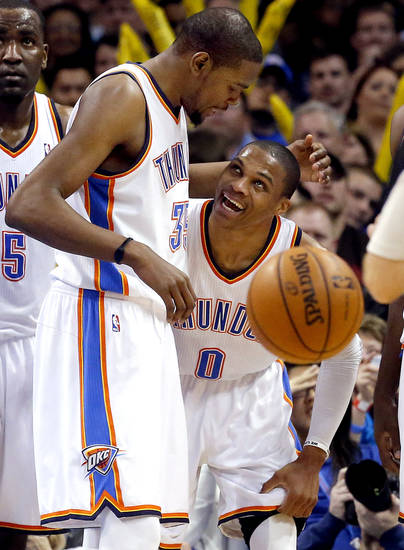 Oklahoma City's Kevin Durant (35) and Russell Westbrook (0) celebrate a play during the NBA basketball game between the Oklahoma City Thunder and the Portland Trail Blazers at the Chesapeake Energy Arena in Oklahoma City, Sunday, March, 24, 2013. Photo by Sarah Phipps, The Oklahoman