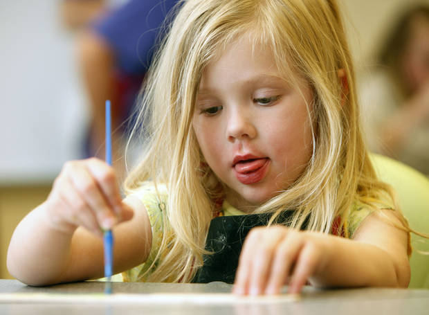 Four-year-old Evelyn Stirling concentrates on her painting as children and their parents create miniature Chihuly chandeliers during the weekly Drop-In Art event at the Oklahoma City Museum of Art in Oklahoma City, OK, Saturday, March 12, 2011. By Paul Hellstern, The Oklahoman