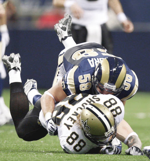 Saints tight end Jeremy Shockey fumbles after he was hit by the Rams' David Vobora. AP photo