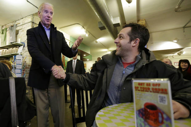 Vice President Joe Biden meets with customers during a visit to the Red Mug Coffee Shop, Friday, Nov. 2, 2012, in Superior, Wis. (AP Photo/Matt Rourke)