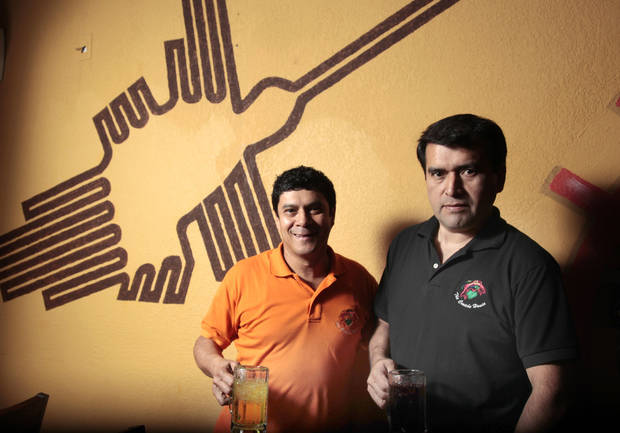 Juan G. Castro, left, and Eduardo Carranza in their restaurant Ceviche House in Warr Acres. <strong>SARAH PHIPPS - THE OKLAHOMAN</strong>