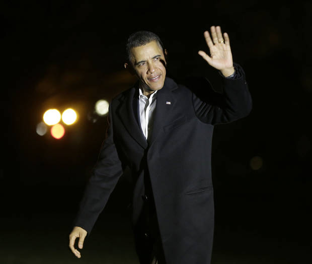 President Barack Obama waves to members of the media as walks across the South Lawn of the White House following his arrival on Marine One helicopter, Monday, Feb. 18, 2013. President Obama was returning from a weekend of golfing in Palm City, Fla. (AP Photo/Pablo Martinez Monsivais)