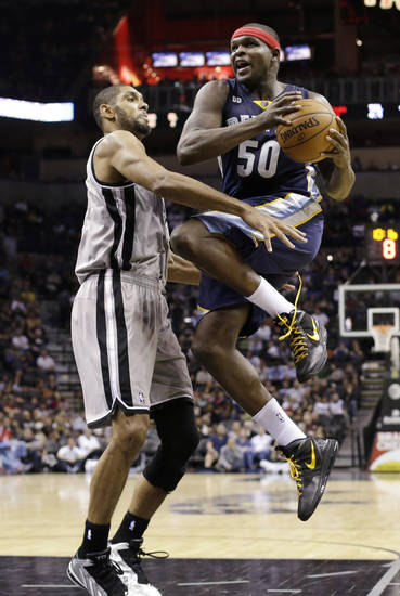 Memphis Grizzlies' Zach Randolph (50) drives to the basket as San Antonio Spurs' Tim Duncan defends during the third quarter of an NBA basketball game, Saturday, Dec. 1, 2012, in San Antonio. (AP Photo/Eric Gay)