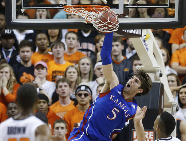 Kansas center Jeff Withey (5) dunks against Oklahoma State during the first half of an NCAA college basketball game in Stillwater, Okla., Wednesday, Feb. 20, 2013. (AP Photo/Sue Ogrocki)