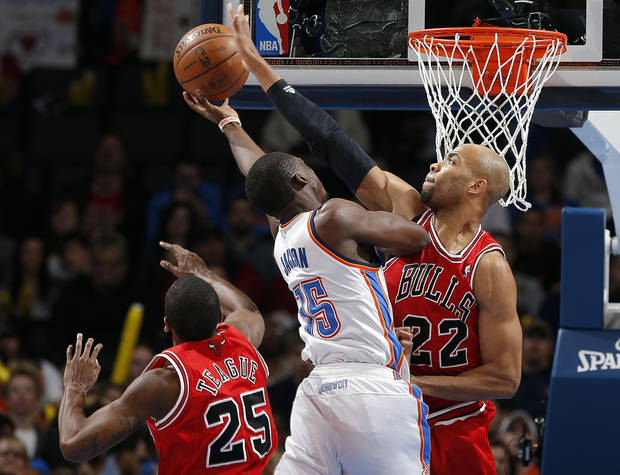 Oklahoma City's Reggie Jackson (15) shoots as Chicago's Marquis Teague (25) and Taj Gibson (22) defend during the NBA game between the Oklahoma City Thunder and the Chicago Bulls at Chesapeake Energy Arena in Oklahoma City, Sunday, Feb. 24, 2013. Photo by Sarah Phipps, The Oklahoman