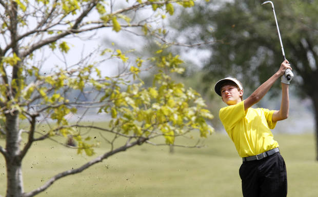 Heritage Hall's Sam Jackson watches his fairway shot during the 4A state golf tournament at Lake Hefner golf course in Oklahoma City , Monday May 6, 2013. Photo By Steve Gooch, The Oklahoman