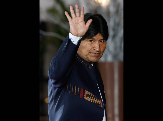 "FILE - In this Tuesday, Oct. 2, 2012, Bolivia's President Evo Morales waves to photographers upon his arrival to the Summit of South American and Arab Countries in Lima, Peru. Morales said Friday, Oct. 12, 2012, during a ceremony marking ""Decolonization Day"" that relations with the U.S. Embassy in La Paz have become so bad they are ""like a turd."" (AP Photo/Karel Navarro, File)"